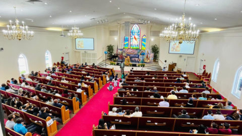 people sitting in church at evangelistical meeting